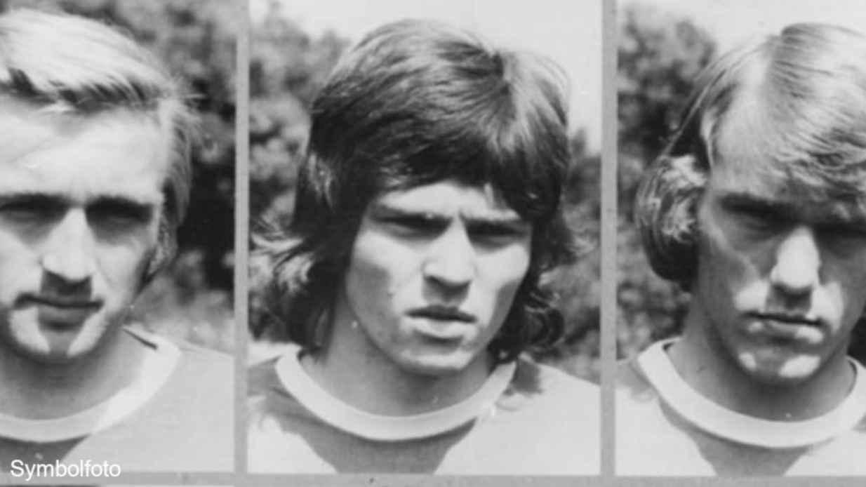 Gesichter von drei Männern.